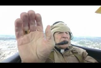 Watch: Archbishop Gregory Aymond blesses city of New Orleans from WWII-era open-air biplane…