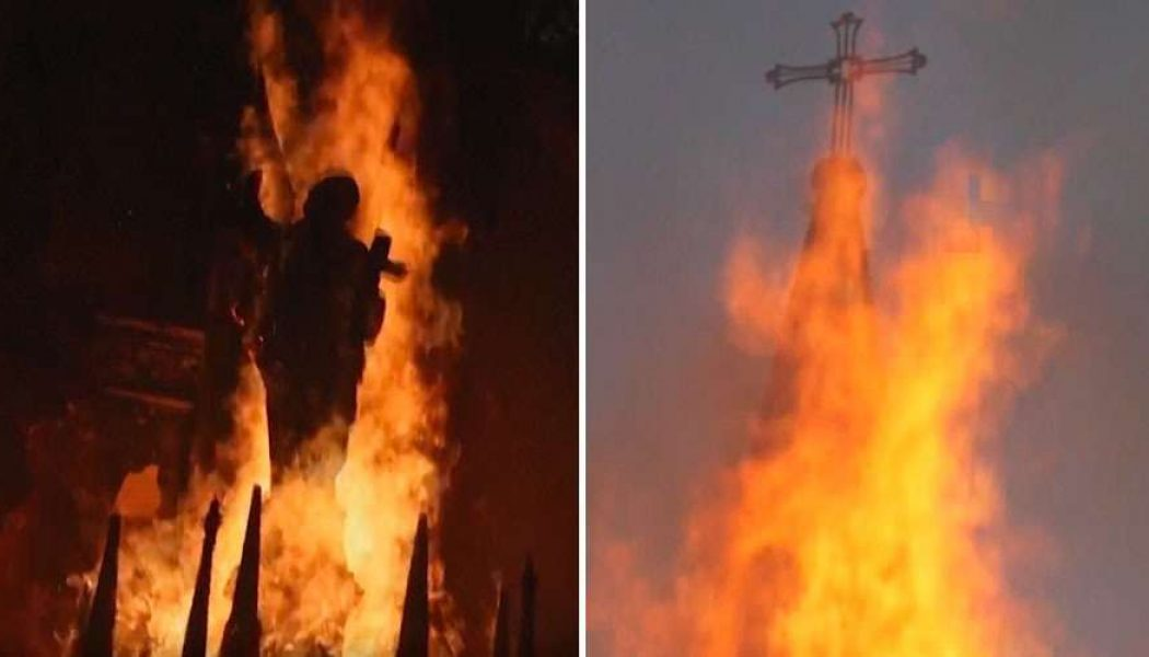 Hooded protestors set fire to two historic Catholic churches in Chile…